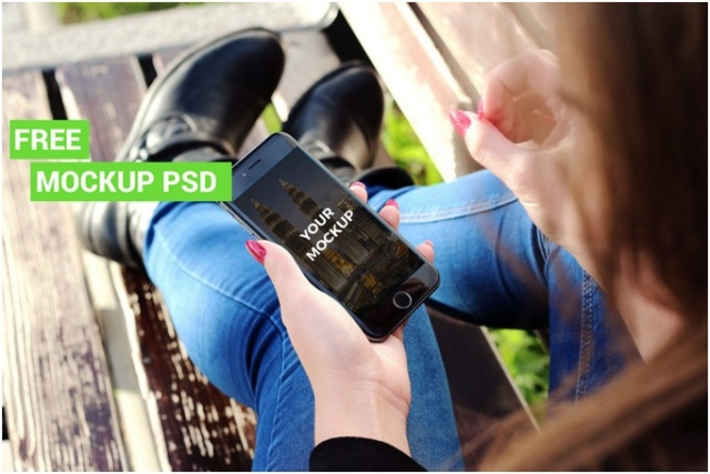 iPhone 6 Mockup in female hand free PSD